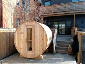 Knotty barrel sauna at home