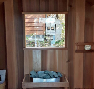 square window in back wall of sauna
